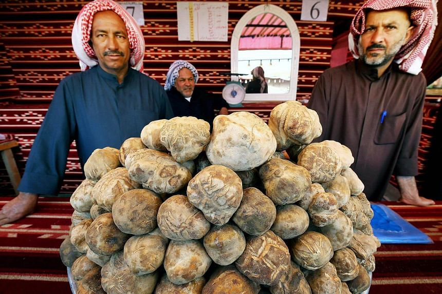 Kuwaiti vendors sell truffles at a market in al-Rai, an industrial zone northwest of Kuwait City on March 1, 2018.