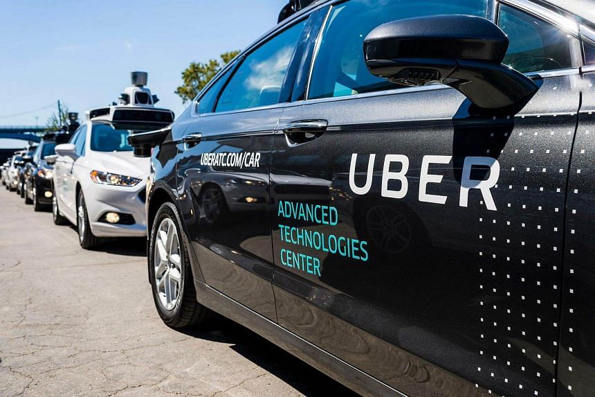 Pilot models of the Uber self-driving car displayed at the Uber Advanced Technologies Center in Pittsburgh, Pennsylvania.