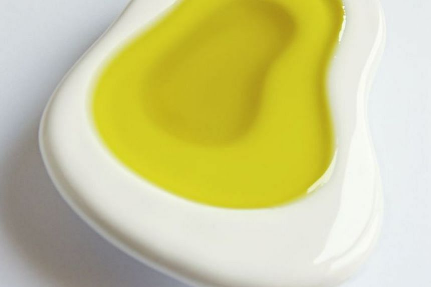Virgin olive oil comes from the first press of the fruit. PHOTO: ST FILE