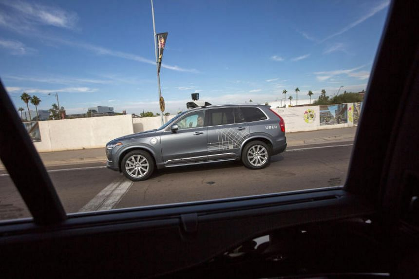 A vehicle operator sits in a self driving Volvo vehicle, purchased by Uber, as it moves along the streets of Phoenix, Arizona, US on Dec 1, 2017.