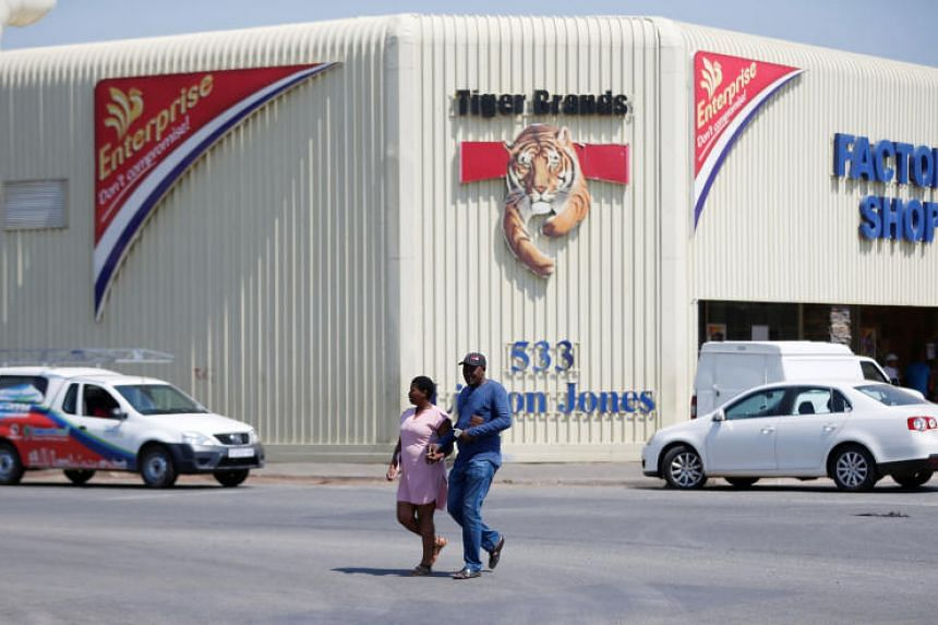 A couple leaves Tiger Brands factory shop in Germiston, Johannesburg, South Africa, on March 5, 2018.