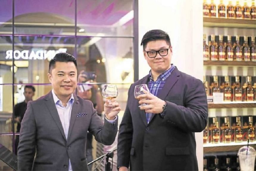 A toast by Emperador Inc executive director Kendrick Tan and Megaworld first vice-president Kevin Tan for Fundador Cafe.