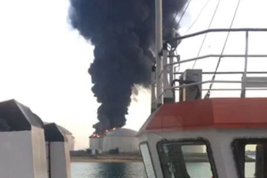 Photos and videos posted on Facebook show dense plumes of smoke rising from Pulau Busing.