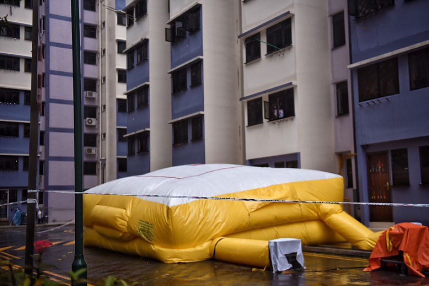 The Singapore Civil Defence Force had set up an inflatable safety life air pack at the foot of Block 114.