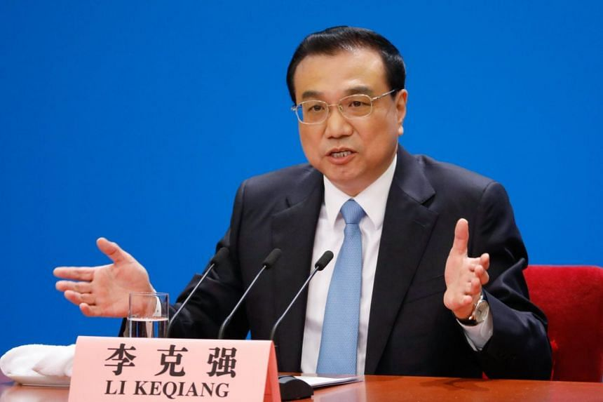 Chinese Premier Li Keqiang gestures as he speaks to reporters during a press conference after the closing of the first session of the 13th National People's Congress at the Great Hall of the People in Beijing, China, on March 20, 2018.