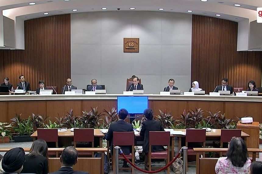 Members of a 10-member Select Committee on disinformation attend at a hearing on March 14, 2018.