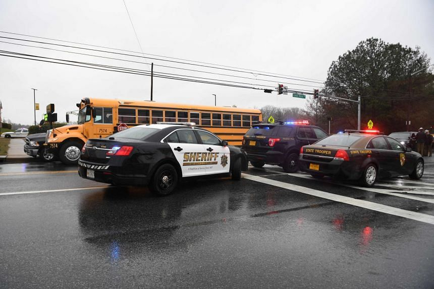 Sheriffs and Maryland State Troopers gather at Great Mills High School after the shooting.