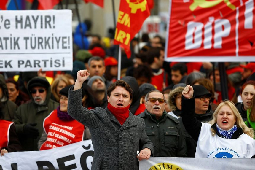 Demonstrators shout slogans during a protest against the government's plan to extend the state of emergency imposed after the 2016 coup attempt for another three months, in Istanbul, on Jan 14, 2018.