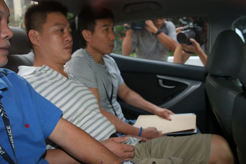 Lim Ying Siang (centre) pleaded guilty to one count each of committing mischief by fire and drug consumption.