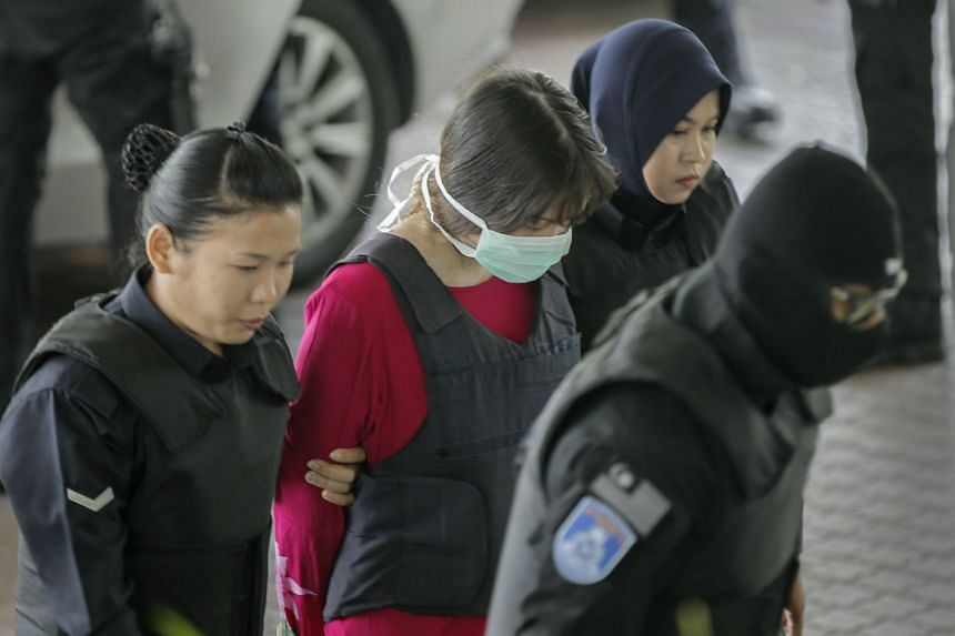 Doan Thi Huong's (centre) lawyer said she had played a prank on a Vietnamese government official in Hanoi less than two weeks before the killing.
