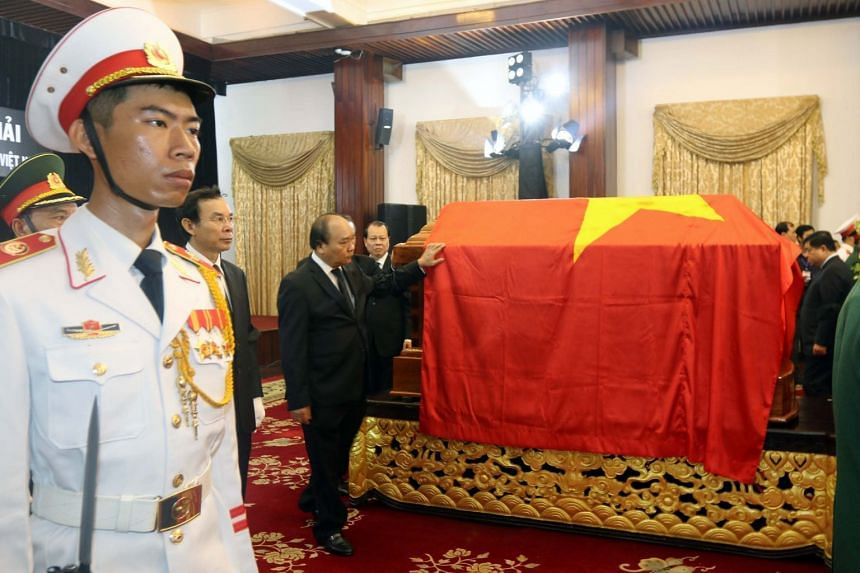 Vietnam's Prime Minister Nguyen Xuan Phuc (centre) attends the funeral of former Prime Minister Phan Van Khai in Ho Chi Minh on March 20, 2018.