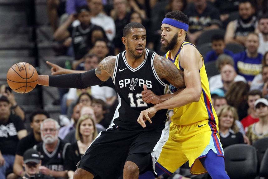 San Antonio Spurs power forward LaMarcus Aldridge (left) posts up against Golden State Warriors center JaVale McGee during the second half at AT&T Center.