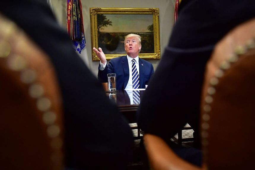 Trump holds a law enforcement roundtable on sanctuary cities at the White House.