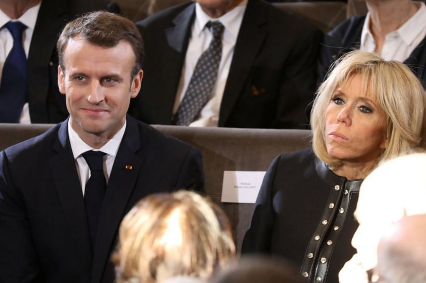 Macron and his wife Brigitte attend a ceremony at the French Institute in Paris, March 20, 2018.