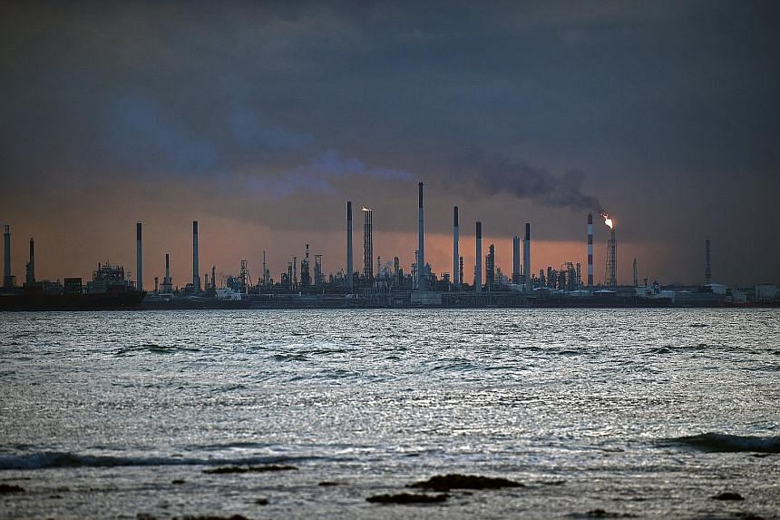 The impending carbon tax is aimed at curbing large emitters from polluting the environment and spurring them to use cleaner sources of energy.