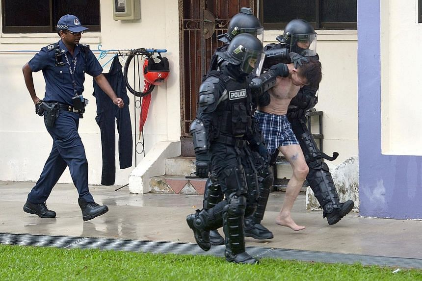 Officers from the Special Operations Command knocked down the door of the flat where the man was and led the suspect out. He was arrested for criminal intimidation and suspected drug-related offences.