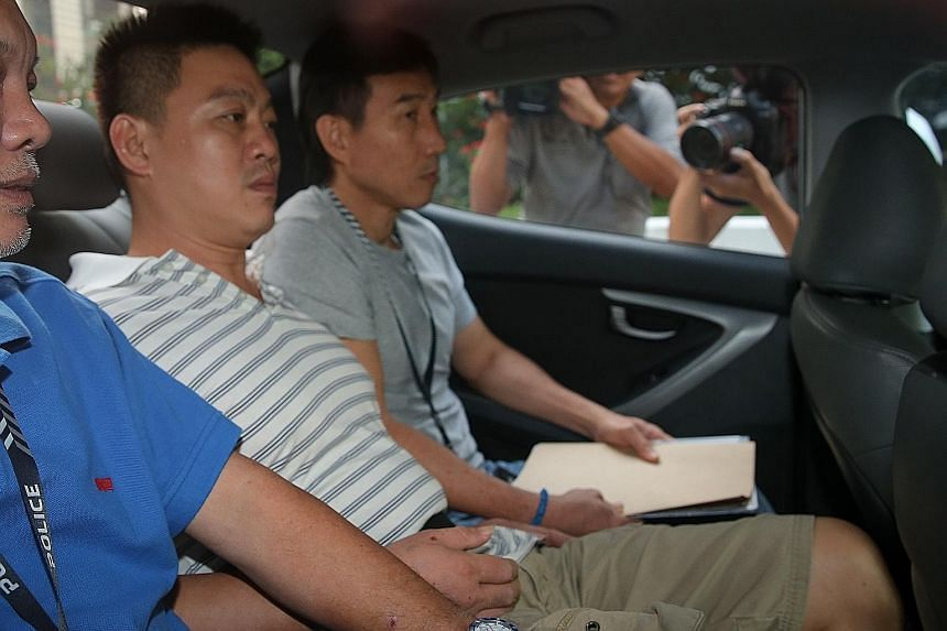Odd-job worker Lim Ying Siang (in striped shirt) pleaded guilty to one count each of committing mischief by fire and drug consumption.