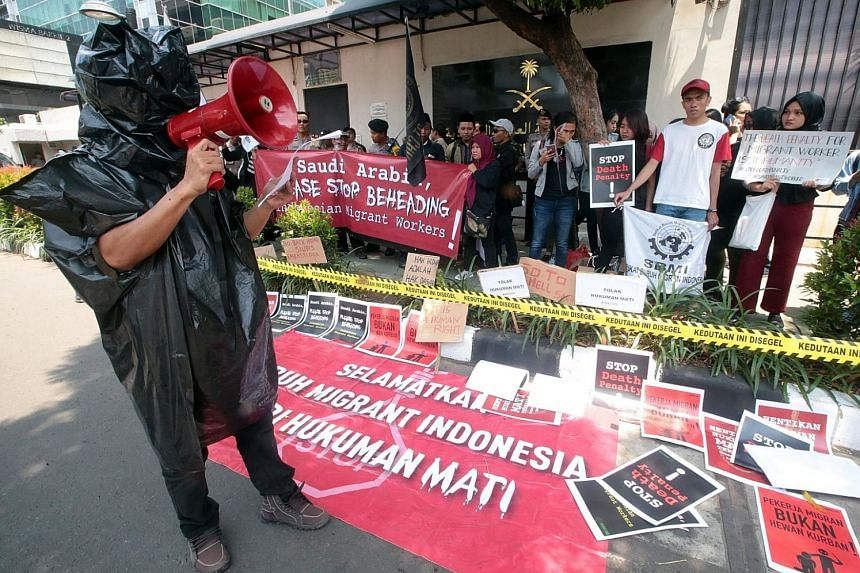 An Indonesian activist speaking during a protest in front of the Saudi Arabian Embassy in Jakarta yesterday against the beheading of Indonesian migrant worker Muhammad Zaini Misrin, 53, on Sunday. Zaini, who had worked as a driver in Saudi Arabia, wa