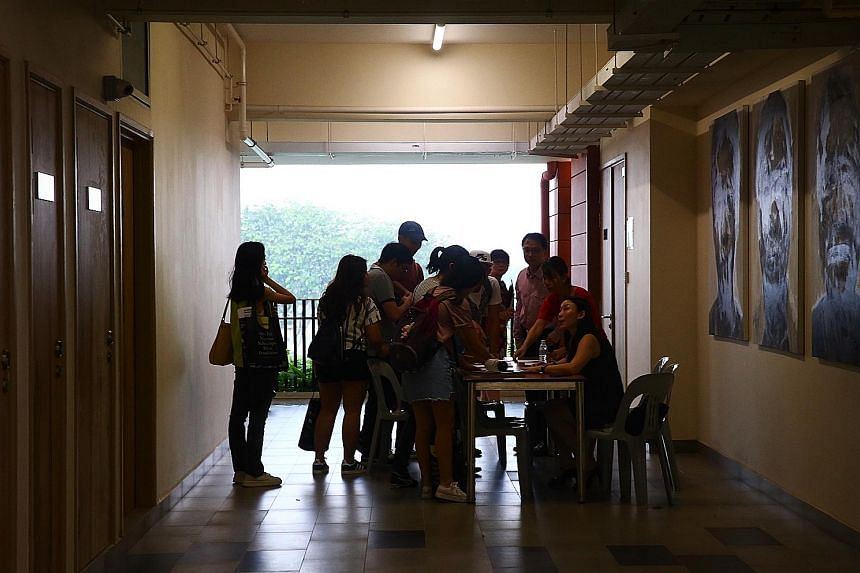 Affected Hwa Chong Institution students checking their names against a register before attending a briefing last month about their missing exam papers.