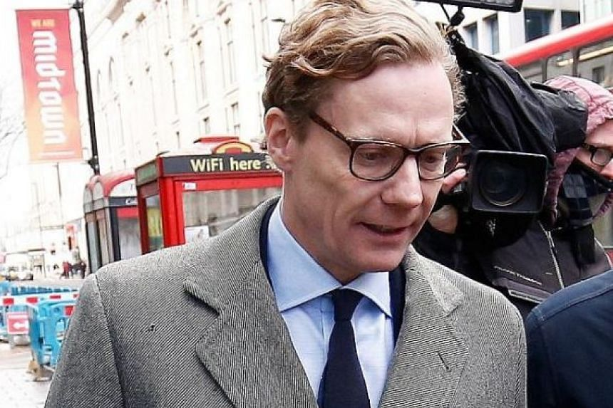 Cambridge Analytica's CEO Alexander Nix (far left) and executive Mark Turnbull were secretly filmed by Channel 4 News boasting about entrapping politicians using honey traps and running fake news campaigns.