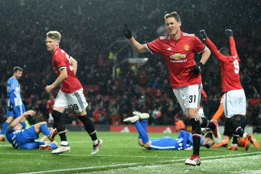 Manchester United's Serbian midfielder Nemanja Matic celebrates scoring the team's second goal during the English FA Cup quarter-final football match against Brighton and Hove Albion at Old Trafford in Manchester, north west England, on March 17, 201