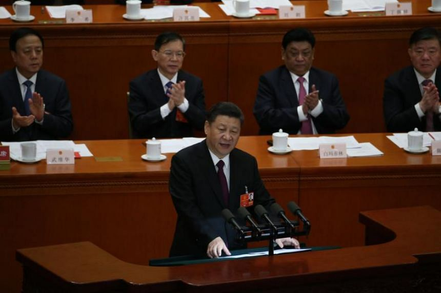 Chinese President Xi Jinping delivers a speech during the closing of the first session of the 13th National People's Congress at the Great Hall of the People in Beijing on March 20, 2018.