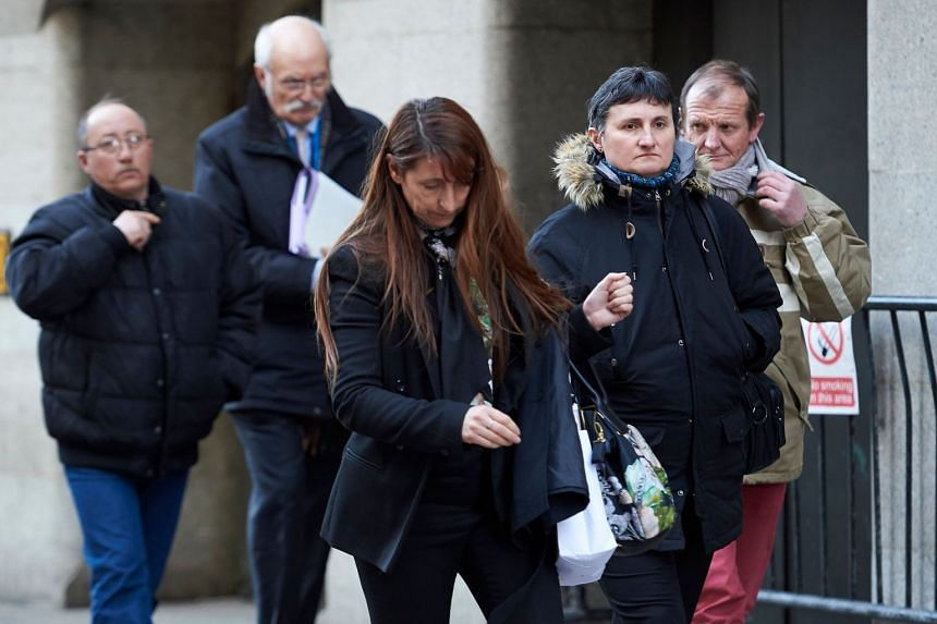 The victim's parents, Catherine Devallonne (second right) and Patrick Lionnet (right), and step-father Stephane Devallonne (left) leave court.