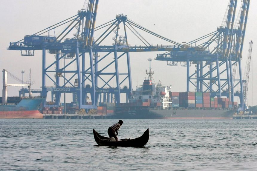A fisherman preparing to cast his nets in front of the port at Vallarpadam, in the Indian city of Kochi. South Asian ministers and entrepreneurs are urging regional integration, at a business conclave in Kathmandu that will begin on March 23, 2018.