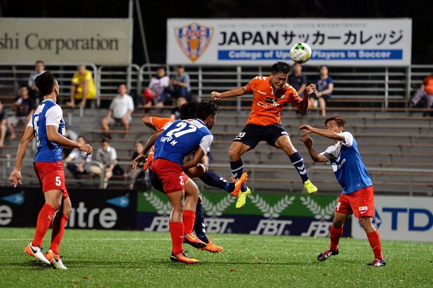 An S-League match between Albirex Niigata (in orange) and the Garena Young Lions on Aug 11, 2016.