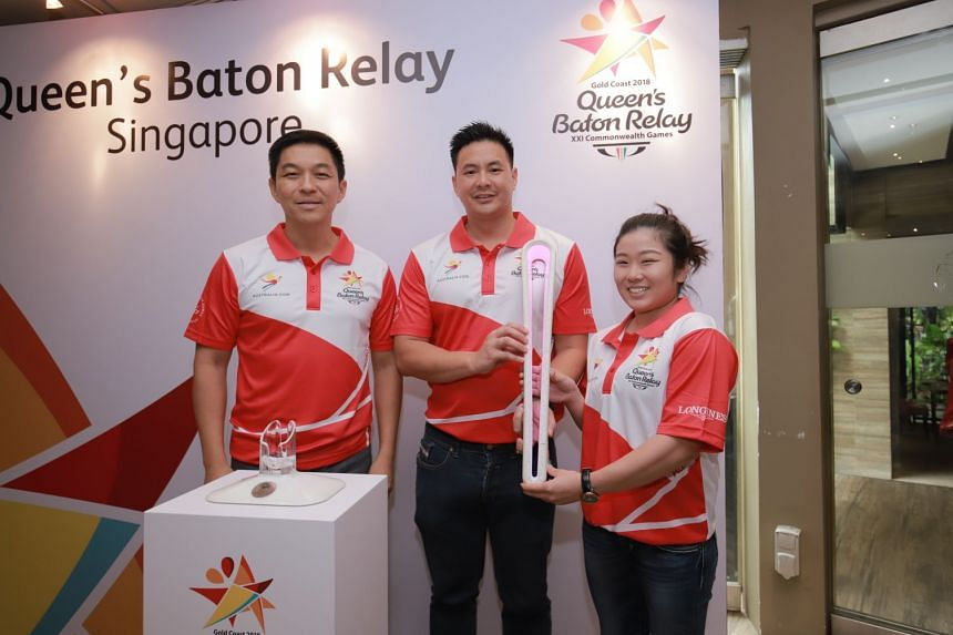 (From left) Singapore National Olympic Council president Tan Chuan-Jin, 2018 Commonwealth Games chef de mission Mark Chay and assistant CDM Lim Heem Wei with the Queen's Baton on Oct 27, 2017.