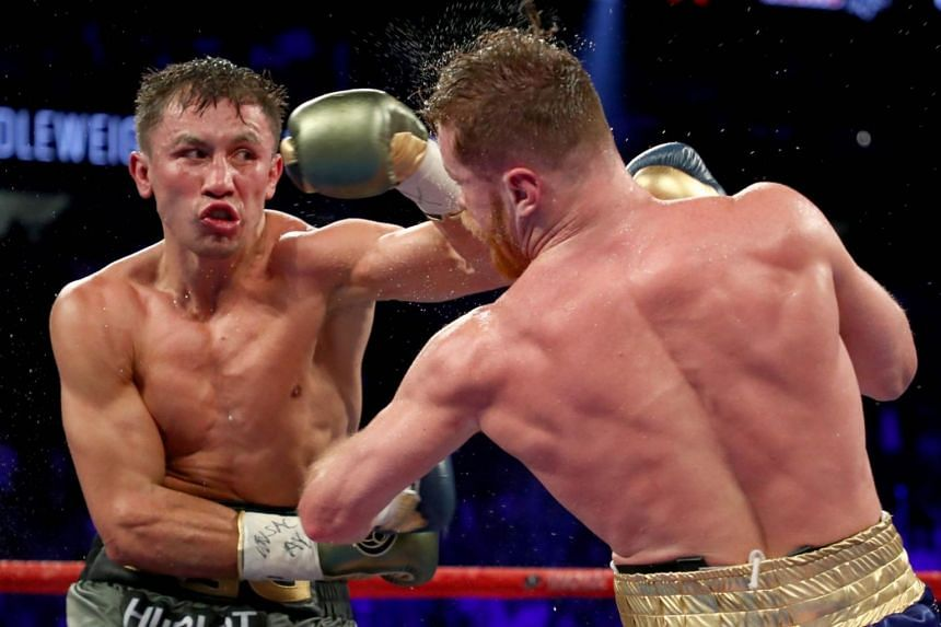 Gennady Golovkin (left) throws a punch at Saul Alvarez during their middleweight championionship bout at the T-Mobile Arena on Sept 16, 2017 in Las Vegas, Nevada.