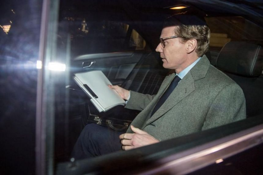 Cambridge Analytica CEO Alexander Nix leaves his offices through the back door in London on March 20, 2018.