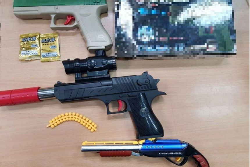 The guns and three packets of pallets were found in the car boot of a Singapore-registered car driven by a Singaporean woman.