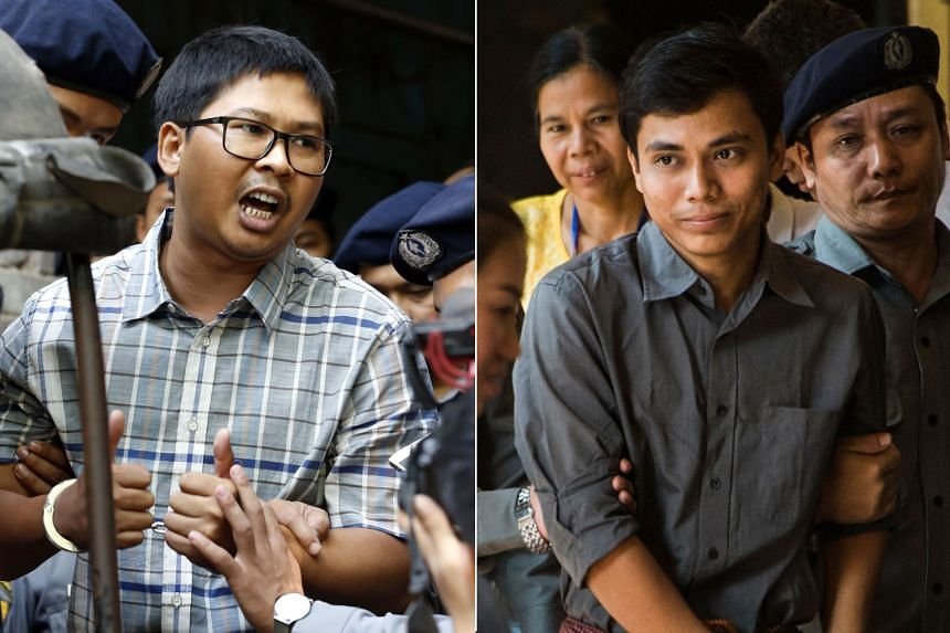 A Yangon court is holding preliminary hearings to decide whether reporters Wa Lone (left) and Kyaw Soe Oo will face charges under the colonial-era Officials Secrets Act.