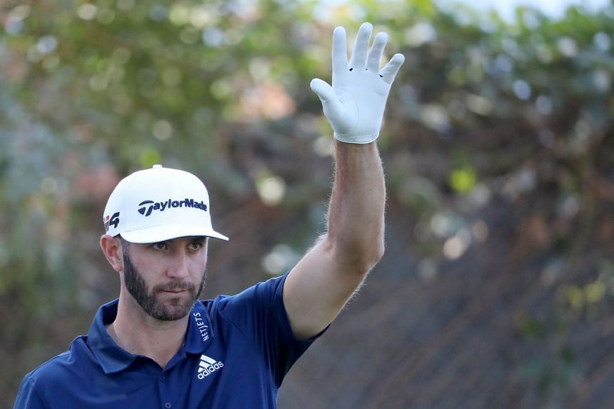 Dustin Johnson acknowledges fans on the 11th tee during the final round of the Genesis Open.