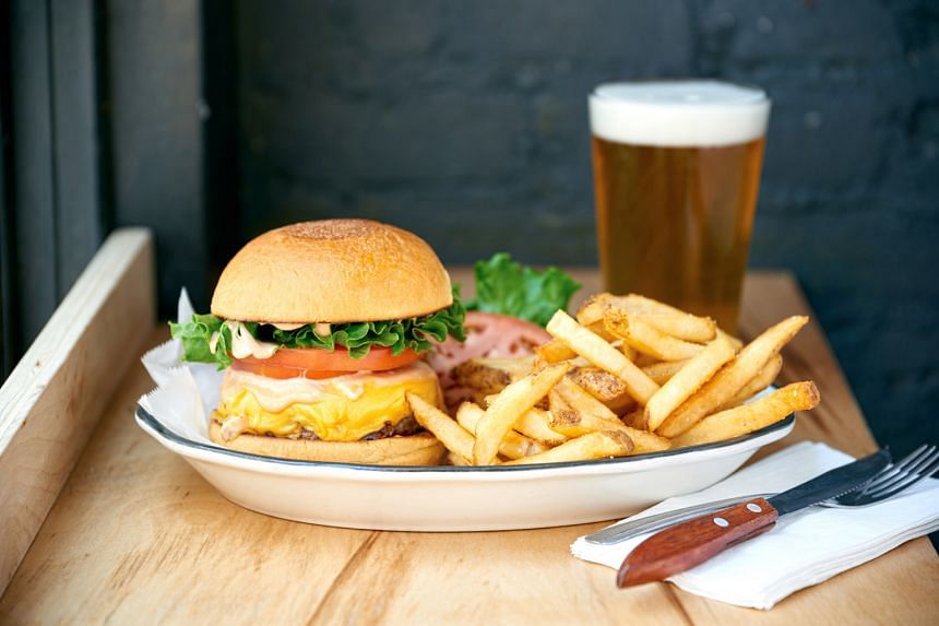 Black Tap Craft Burgers & Beer will serve its iconic craft burgers, such as the All-American Burger (above).