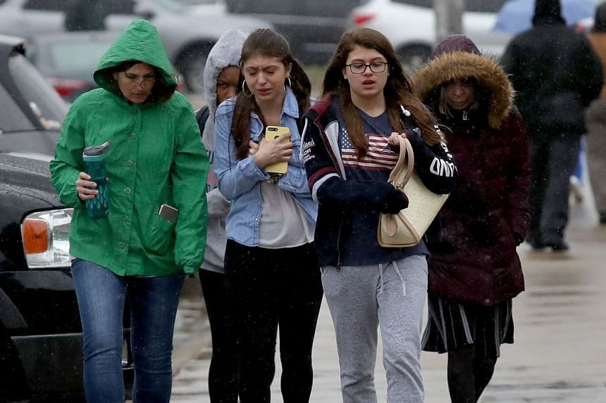 Students walk to meet their parents after the shooting.