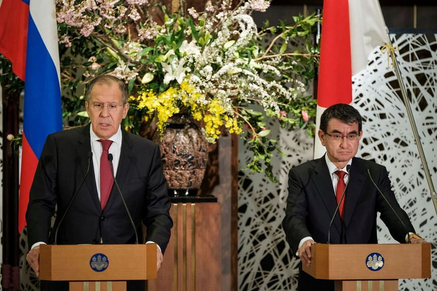 """""""More than anything, the fact-finding process is important,"""" Japanese Foreign Minister Taro Kono (right) told a news conference with Russian counterpart Sergey Lavrov beside him."""