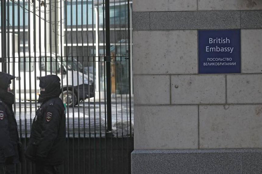 Russian policemen guard outside the British embassy in Moscow, on March 17, 2018.