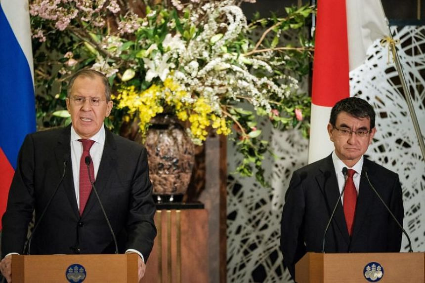 Japan's foreign affairs minister Taro Kono (right) and Russian foreign affairs minister Sergei Lavrov attend a joint press conference after their meeting at the Iikura House in Tokyo on March 21, 2018.