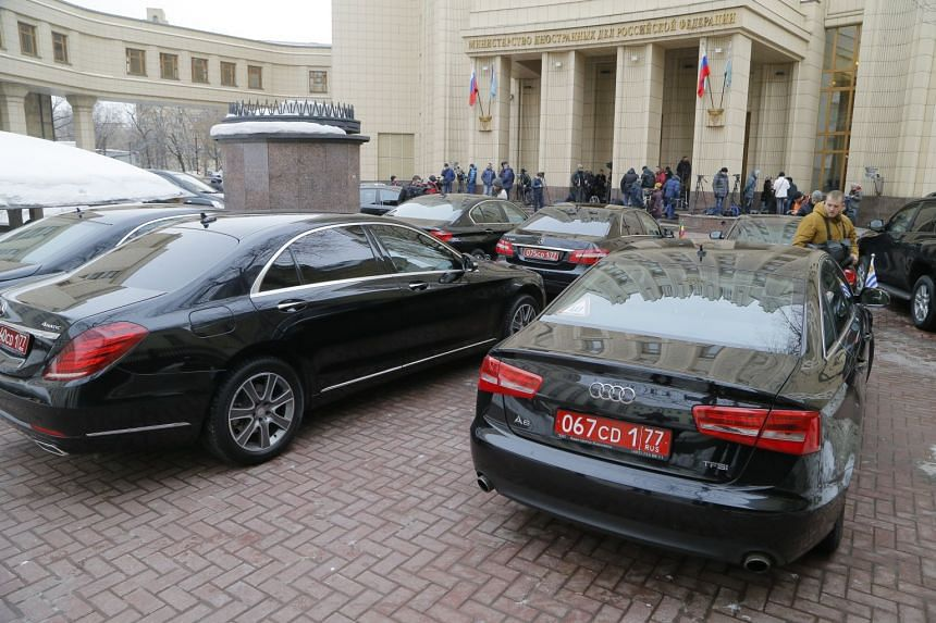 Cars of foreign diplomats are parked near the Russian Foreign Ministry building in Moscow.