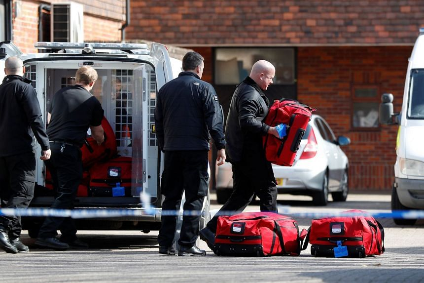 Police officers prepare equipment as inspectors from the Prohibition of Chemical Weapons begin work at the scene of the nerve agent attack.