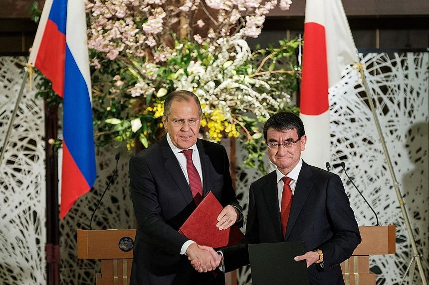 Russian Foreign Minister Sergei Lavrov (left) and his Japanese counterpart Taro Kono at the Iikura House in Tokyo yesterday.