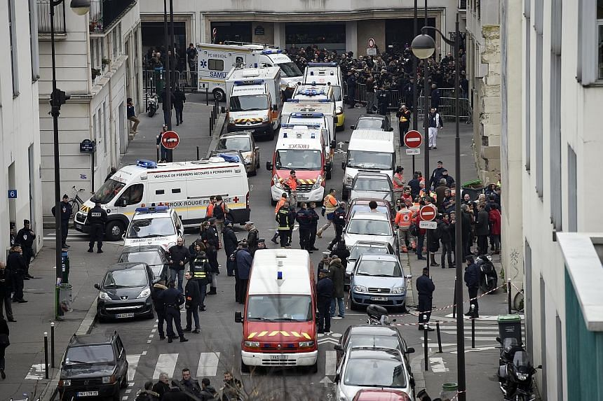 The scene outside the offices of French satirical newspaper Charlie Hebdo in Paris on Jan 7, 2015, after gunmen launched a deadly attack.