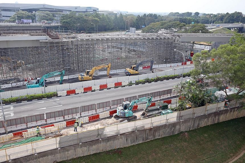 """Work on the road level being done at the Upper Changi Road East viaduct site yesterday. An MOM spokesman said the stop-work order on the viaduct structures """"is still in force"""", but permission has been granted for the main contractor to continue with"""
