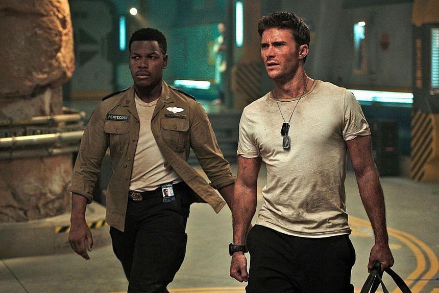 Pacific Rim: Uprising stars John Boyega (far left) and Scott Eastwood.
