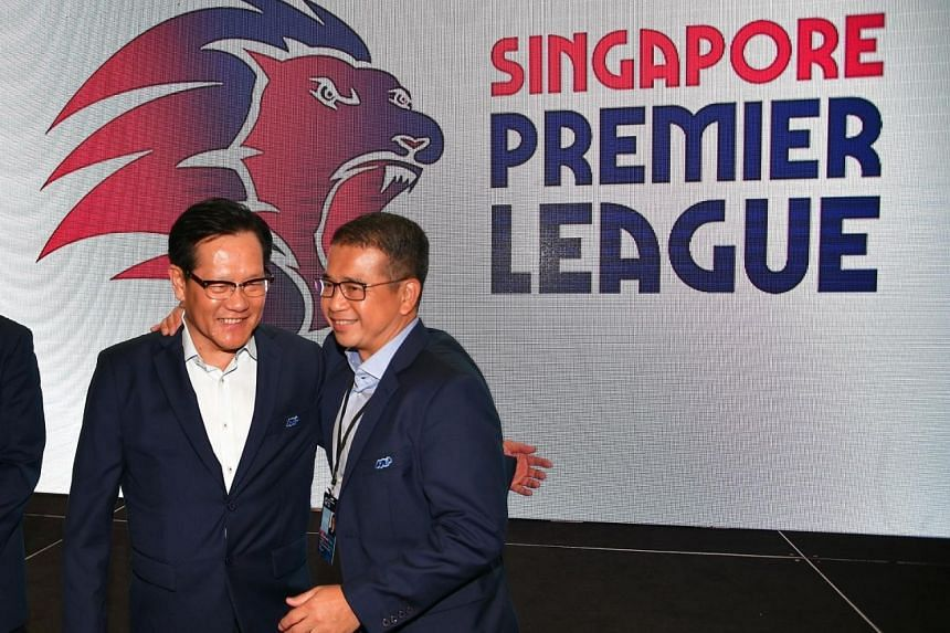 FAS president Lim Kia Tong (left) and vice-president Edwin Tong presenting the league's new logo, which features a red and blue roaring lion - the colours of Singapore and the FAS, respectively.