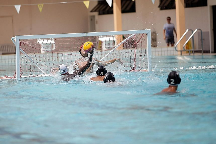 An Anglo-Chinese School (Independent) player taking aim at goal in yesterday's Schools National B Division water polo final. ACS(I), last year's runners-up after a stunning upset by Outram Secondary, defeated Hwa Chong Institution 10-3 at the Co-Curr
