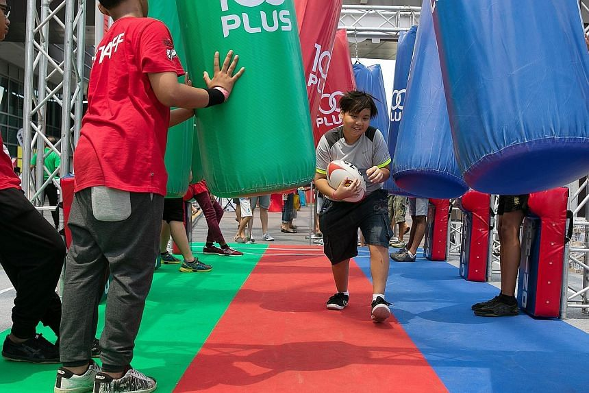 A boy having fun at the kids' zone during the tournament two years ago. There will be plenty of fringe activities for families at the HSBC Singapore Sevens competition at the National Stadium at the end of next month.