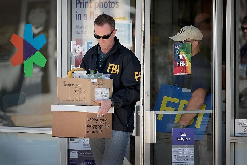 An FBI agent collecting evidence after an explosion at a FedEx sorting facility near San Antonio, Texas, on Tuesday. Emergency responders at the scene where bombing suspect Mark Anthony Conditt killed himself by detonating a device in his car, while